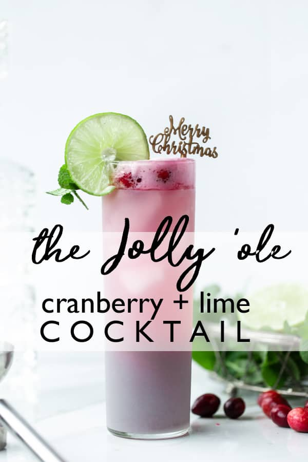 The Jolly Ole  Christmas Cocktail is festive without being over-the-top. Light and fruity with just the perfect amount of red and green holiday cheer! christmas cocktail recipes | cranberry mint cocktail | vodka cocktails | holiday drink ideas