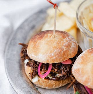 Seasoned with cocoa chili dry rub, braised until fall-apart tender and crispy, bathed in chocolate chili barbecue sauce and piled high with cilantro lime coleslaw and quick pickled onions and radishes