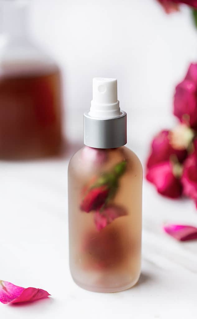 spray bottle with rose buds and homemade rosewater