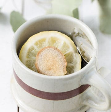 A hot mug of ginger lemon green tea