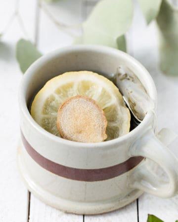 A hot mug of ginger lemon green tea