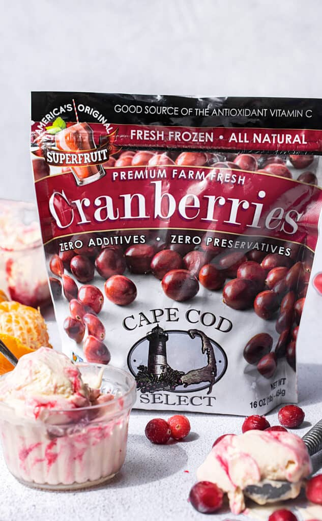 Frozen cranberries and mandarin orange ice cream