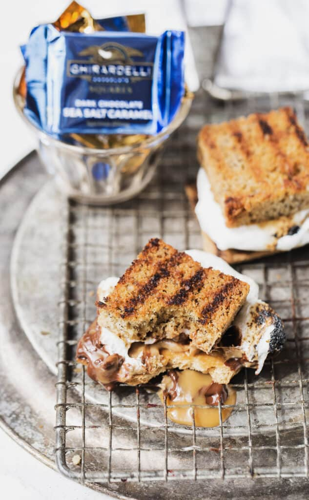 toasted banana bread s'more with a bite out of it, melted chocolate and ooey caramel