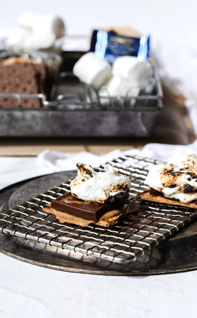 toasted gooey marshmallow on melted chocolate and a toasted graham cracker