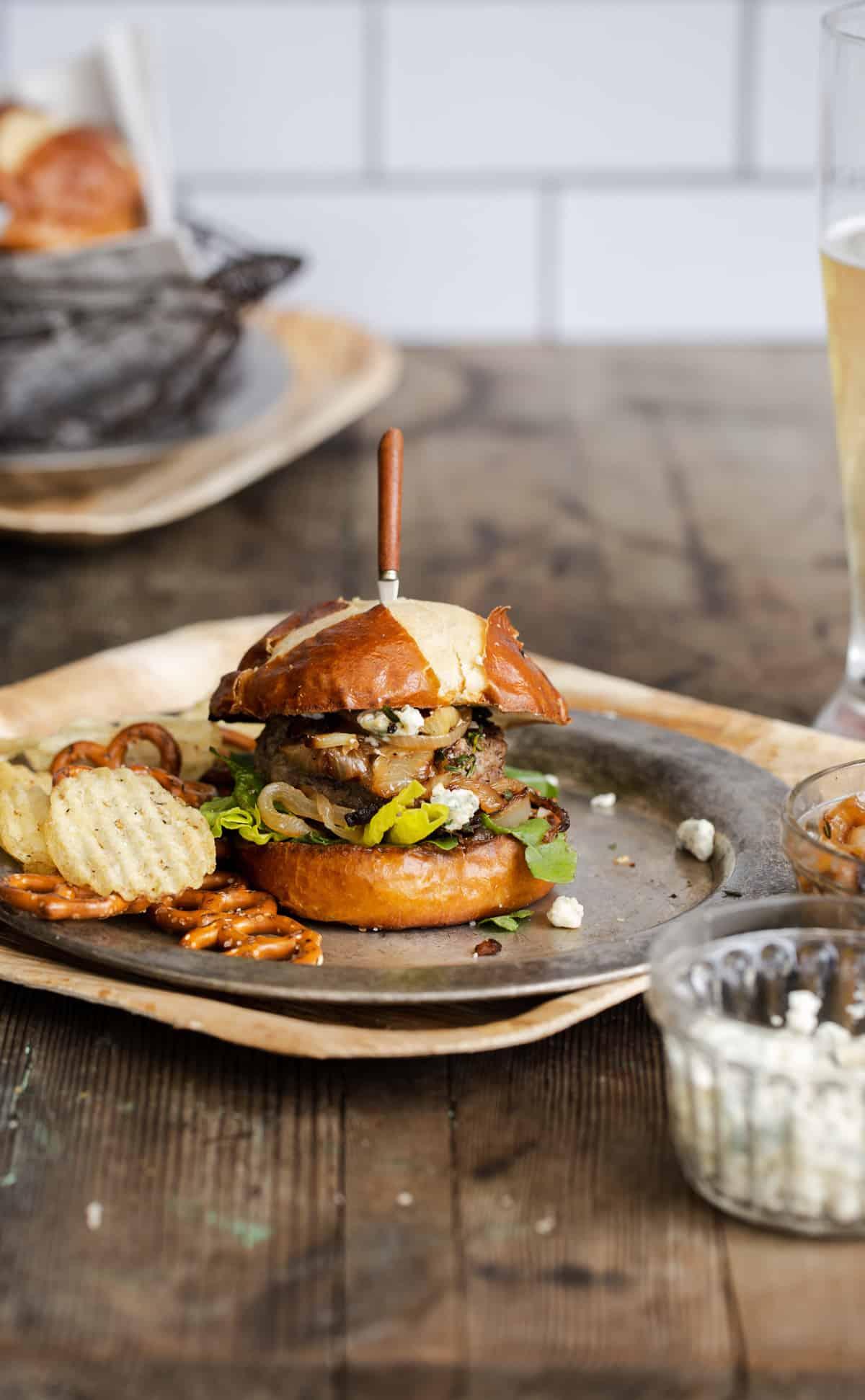 Blue cheese stuffed burger with pretzels on pretzel bun