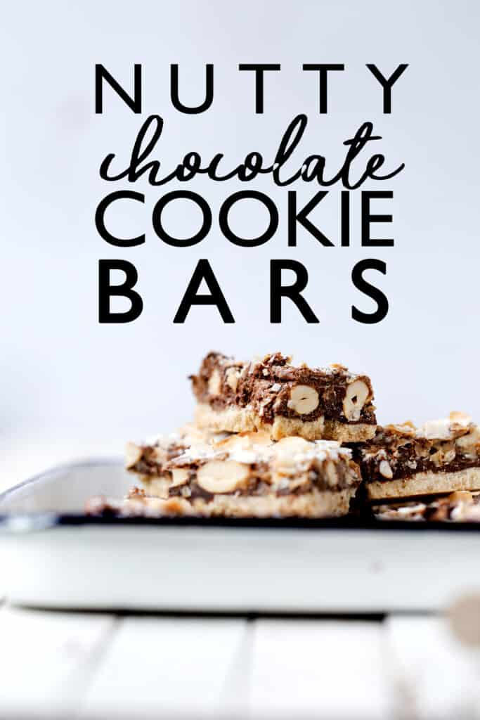 Nutty Chocolate Cookie Bars with sugar cookie crust, butterscotch, chocolate and nuts - the perfect mix of sweet, salty, chewy and crunchy! magic cookie bars | coconut bars | sheet pan sugar cookie | gooey chocolate chip recipe