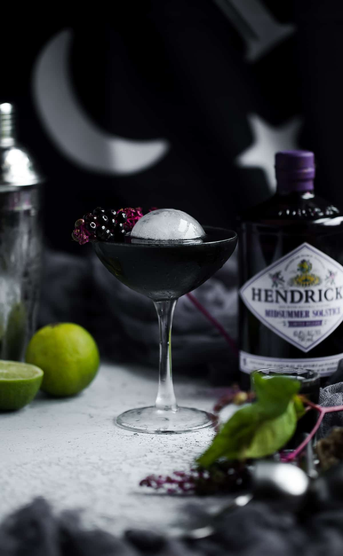 Black halloween cocktail recipe with gin and sphere ice