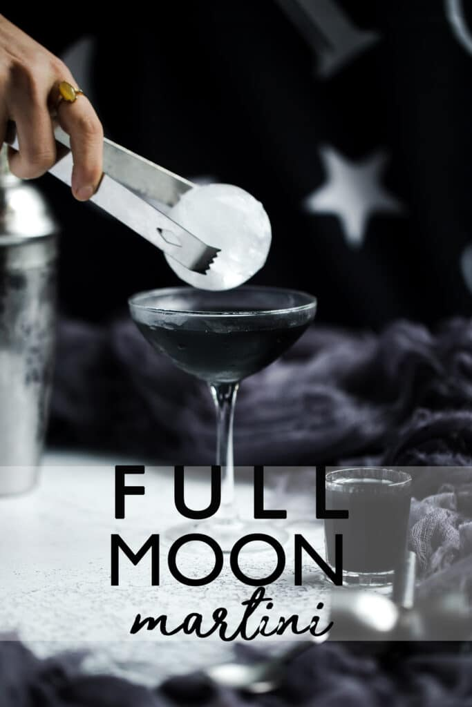 The Full Moontini is a sparkly, tropical flavored black Halloween cocktail recipe made with infused liquor that's delicious all year long. Halloween cocktails | Halloween drinks | Black cocktails | halloween cocktail recipes | charcoal infused | mocktail