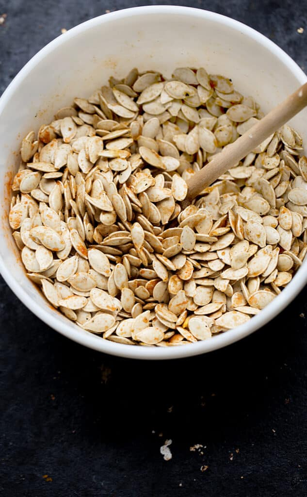 Sweet Spicy Roasted Pumpkin Seeds coated in savory brown sugar caramel that cools into  candy-like roasted pumpkin seed clusters. roasted pumpkin seeds   pumpkin seeds recipe   candied pumpkin seeds   savory caramel coated seeds