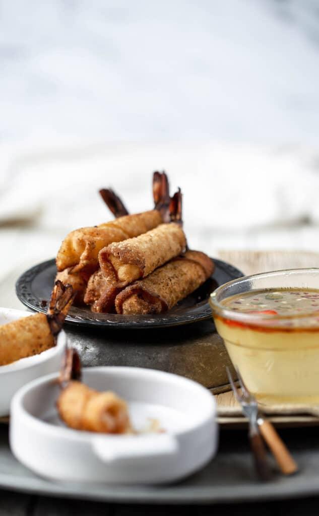 Delicious stack of crispy fried firecracker shrimp rolls