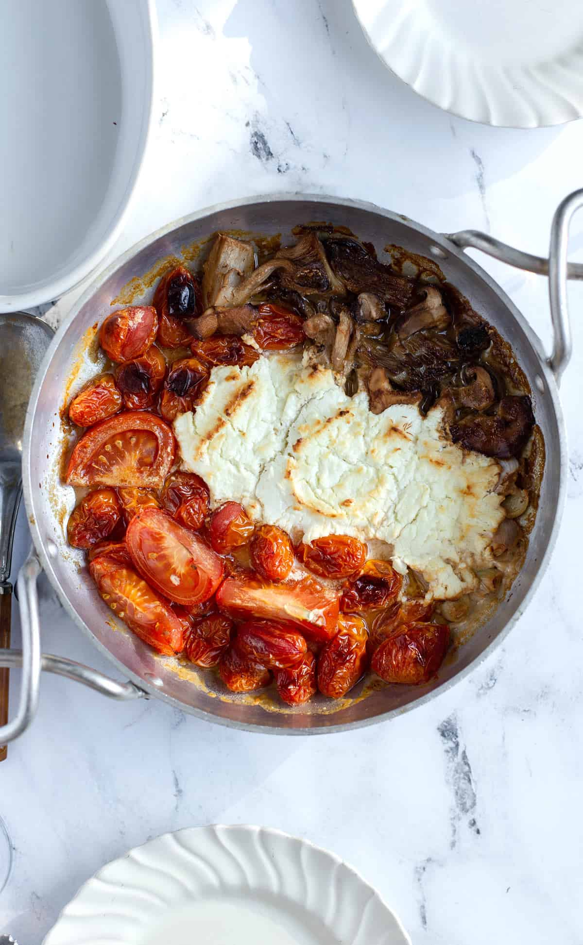 Roasted Tomato Goat Cheese Wild Mushroom Toasts are a simple and easy appetizer with bubbly baked cheese, bursting cherry tomatoes and perfectly roasted mushrooms served in a skillet with garlic toast. bruschetta recipe | skillet dip | goat cheese mushroom toasts | baked cheese recipe
