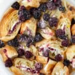 Blackberries and Cream Croissant French Toast Bake is an easy make ahead breakfast recipe with crispy croissants and the sweet flavors of berries and cream. overnight French toast casserole recipe | Blackberry recipes | Brunch recipes | easy cream cheese stuffed French toast | make ahead breakfast