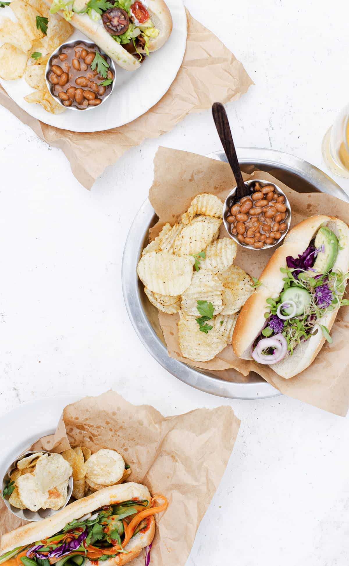 A variety of gourmet hot dog topped hot dogs with sides