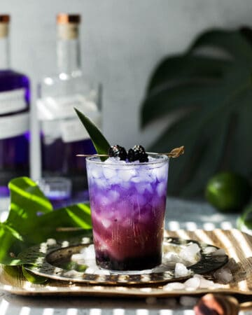 a layered purple and pink gin cocktail