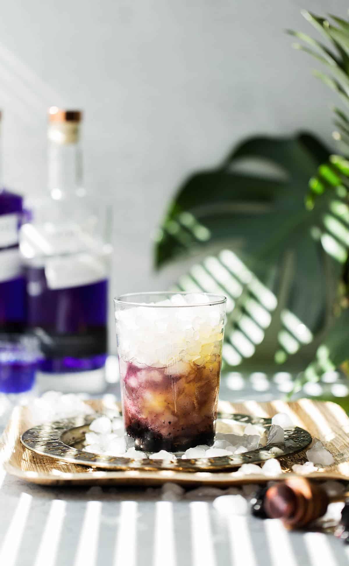Pineapple juice and blackberries on ice