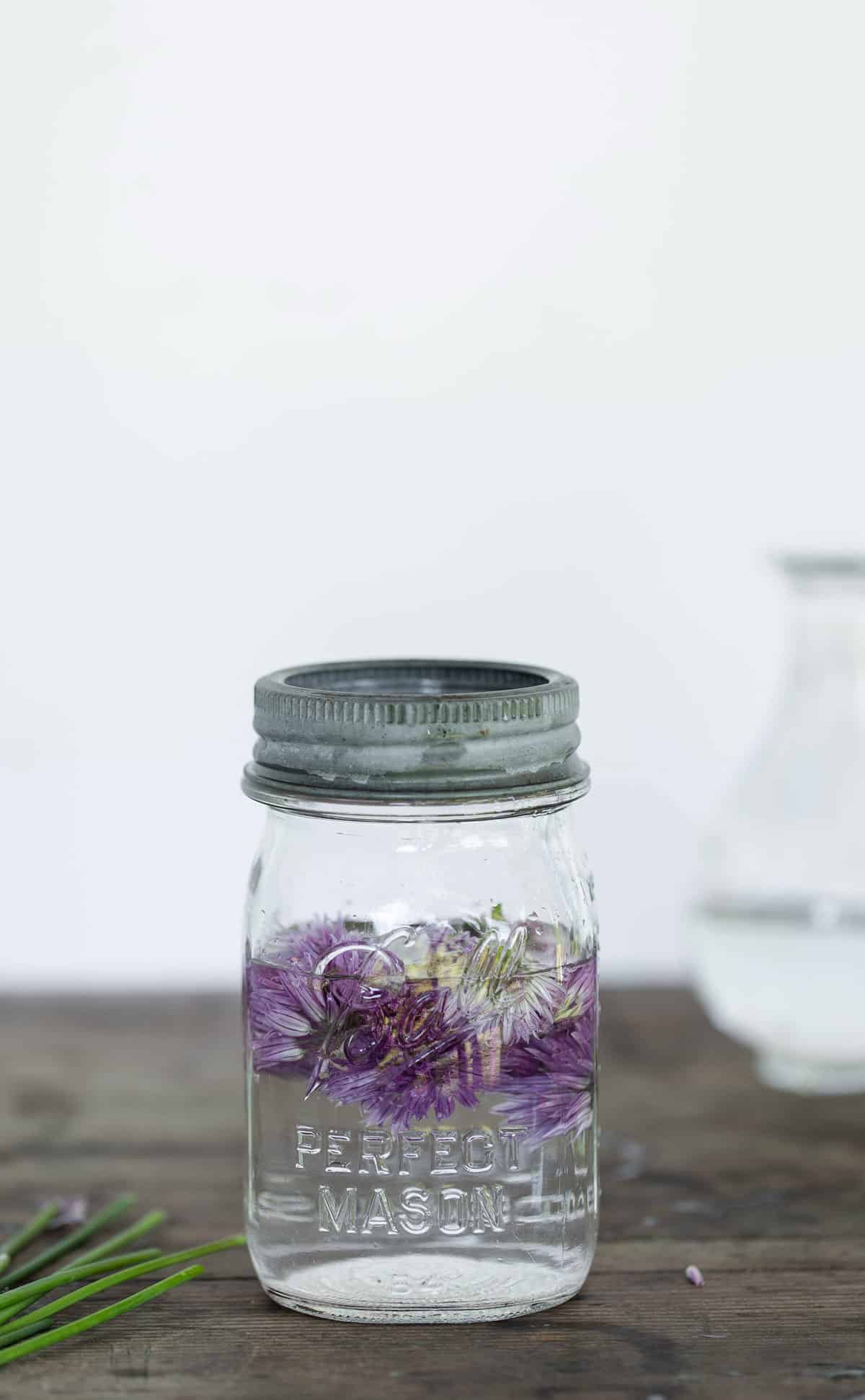 To make pickled chive blossoms simply add steeped blossoms to a small jar and fill with a mixture of vinegar, water, sugar and salt. Refrigerate and consume pickled chive blossoms within a week.