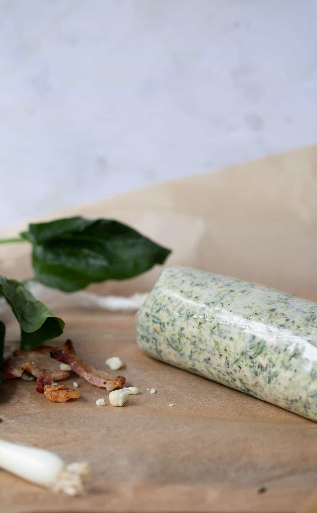 Bacon, spinach, blue cheese compound butter wrapped tightly in plastic wrap