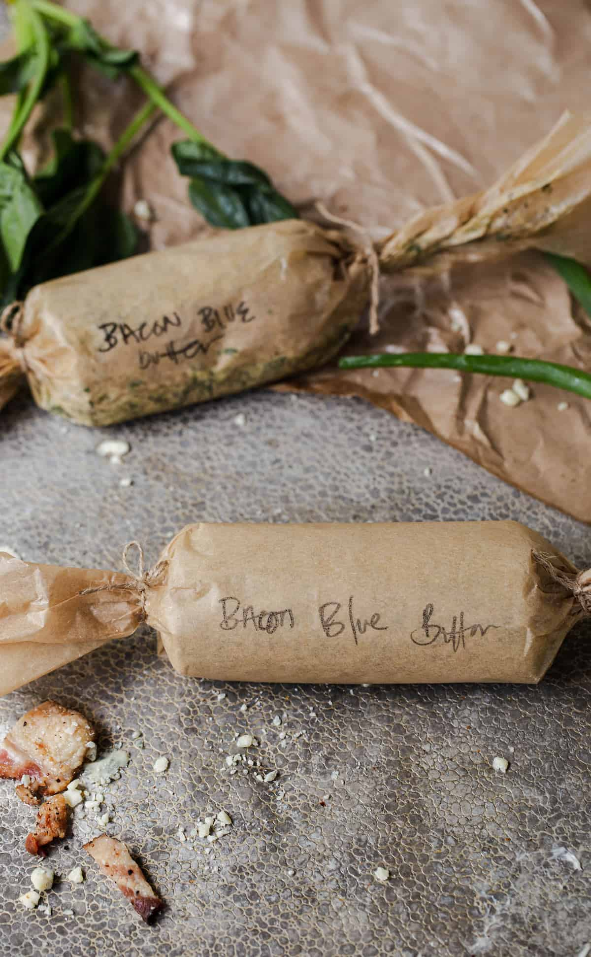 Bacon Blue Cheese Compound Butter logs wrapped and refrigerated to use as needed