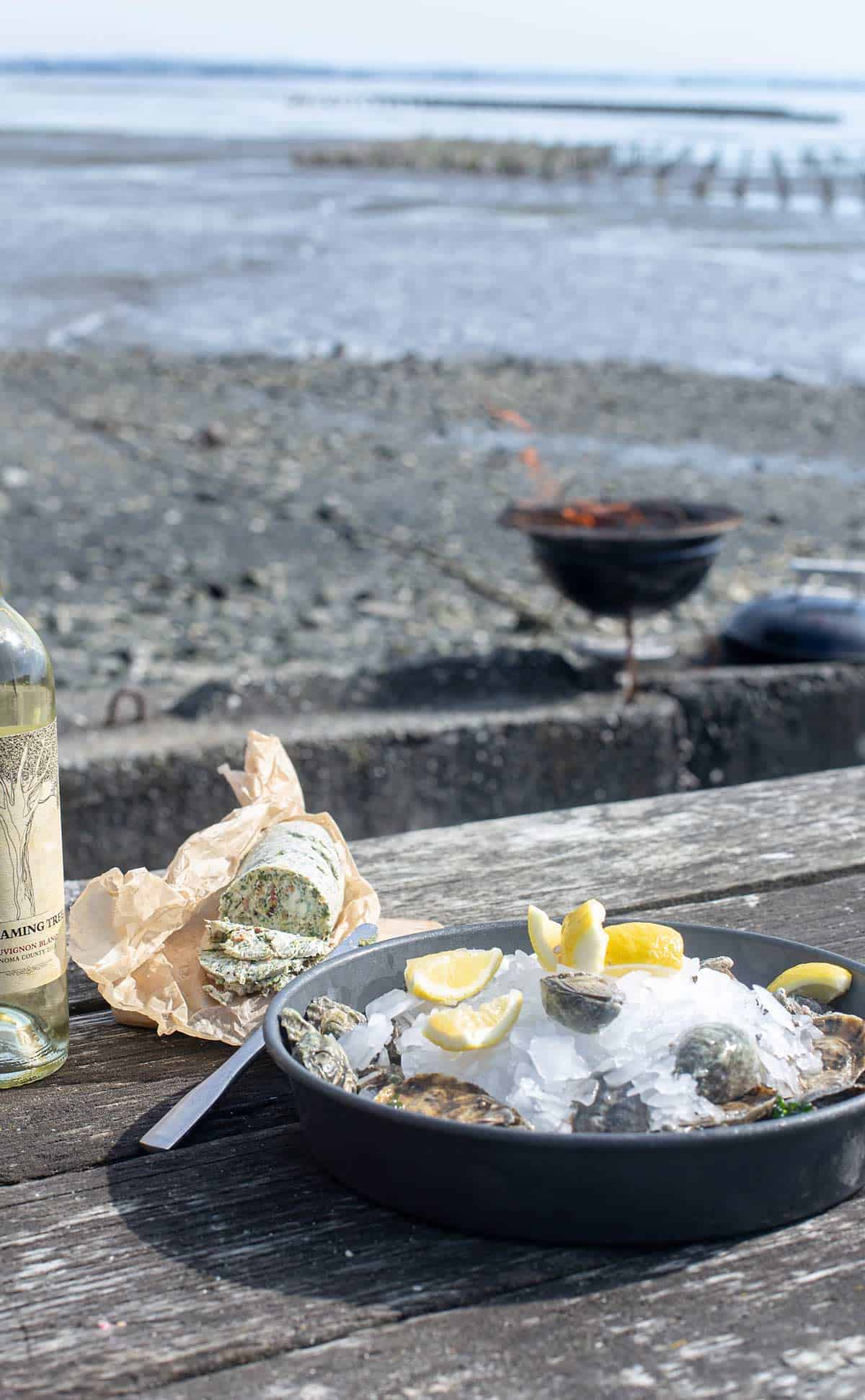 Bacon Blue Cheese Compound Butter with fresh oysters and wine on the beach